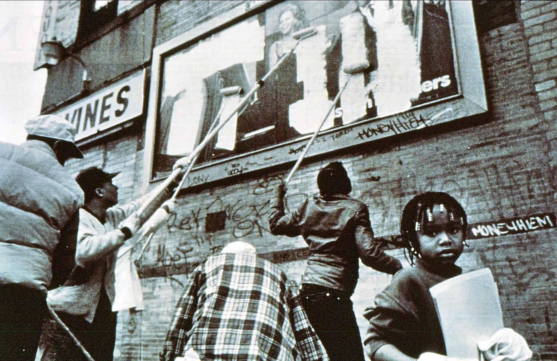 1990 Calvin Butts Defacing Harlem Billboard