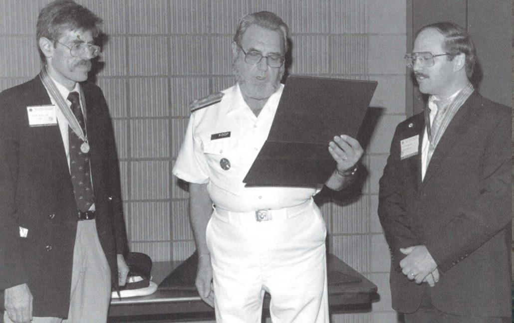 Dr. C. Everett Koop presents Drs. Rick Richards and Alan Blum with the Surgeon General's Medallion, 1988