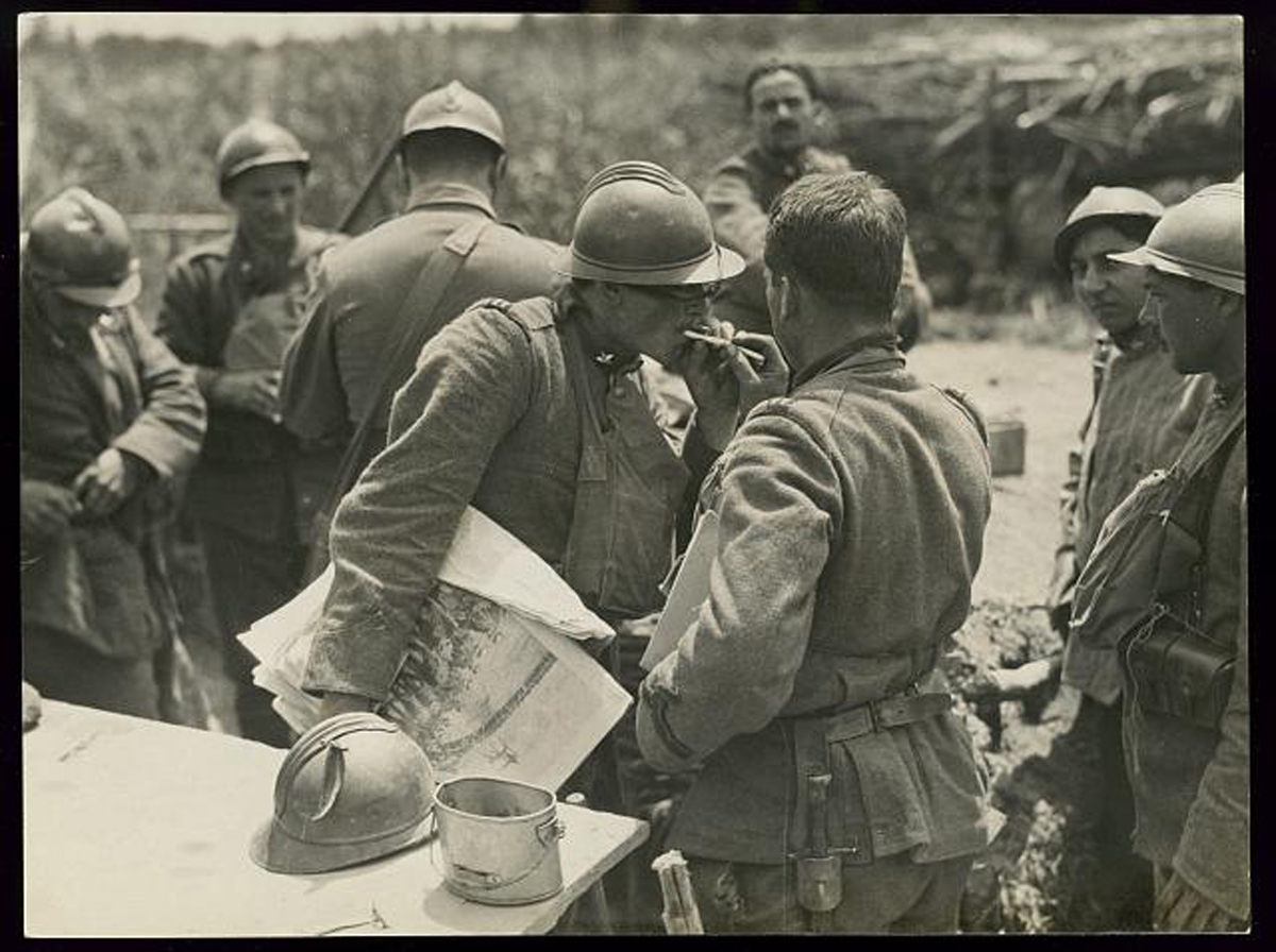 n.d. LOC Army Signal Corps Italian soldier holding illustrated newspaper gets his cigarette lit by another soldier near Piave River Italy