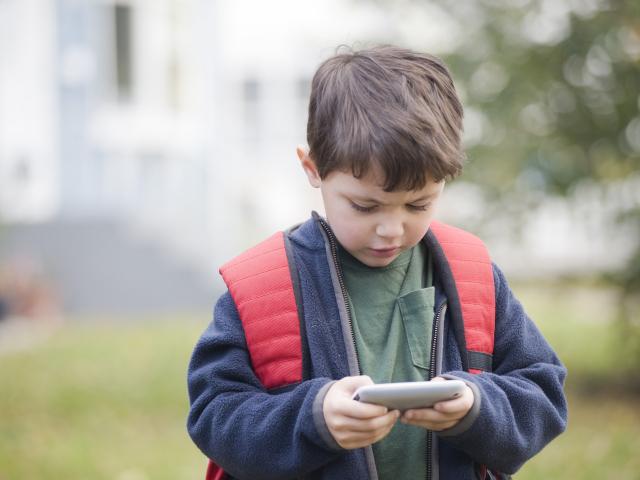 Kindergarten student with phone