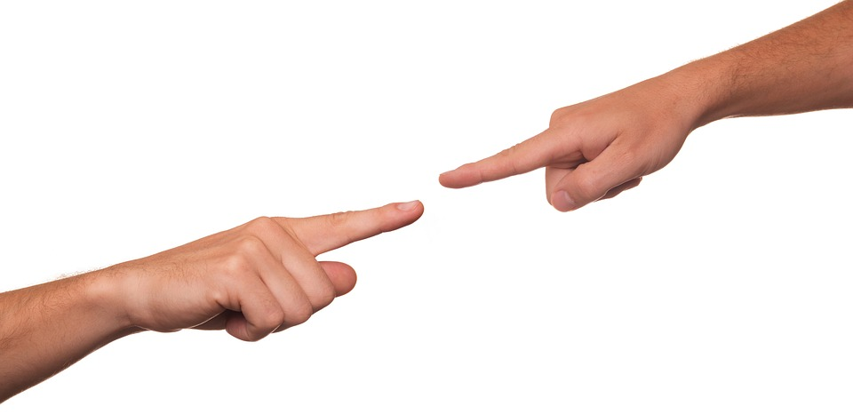 Fingers Pointing At One Another