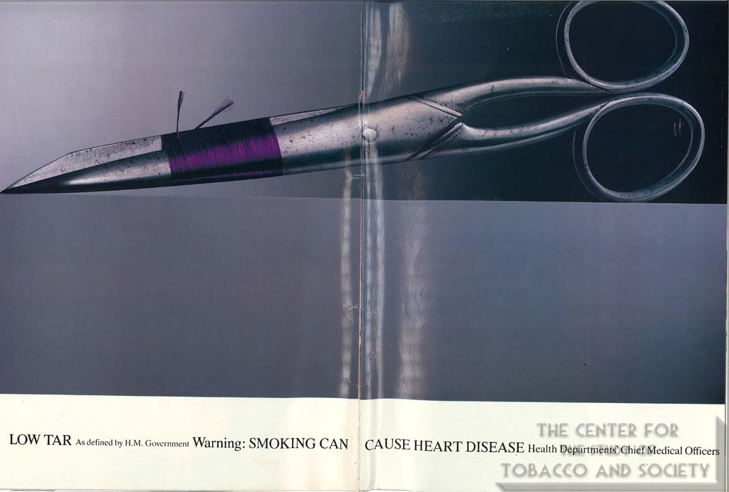 Pair of Scissors Wrapped in Purple Silk Thread - Advertisement - Mayfair - May 20, 1994